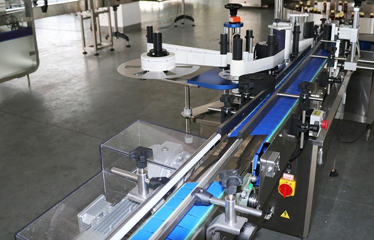 Automatinė apvalaus butelio lipnių lipdukų etikečių klijavimo mašina